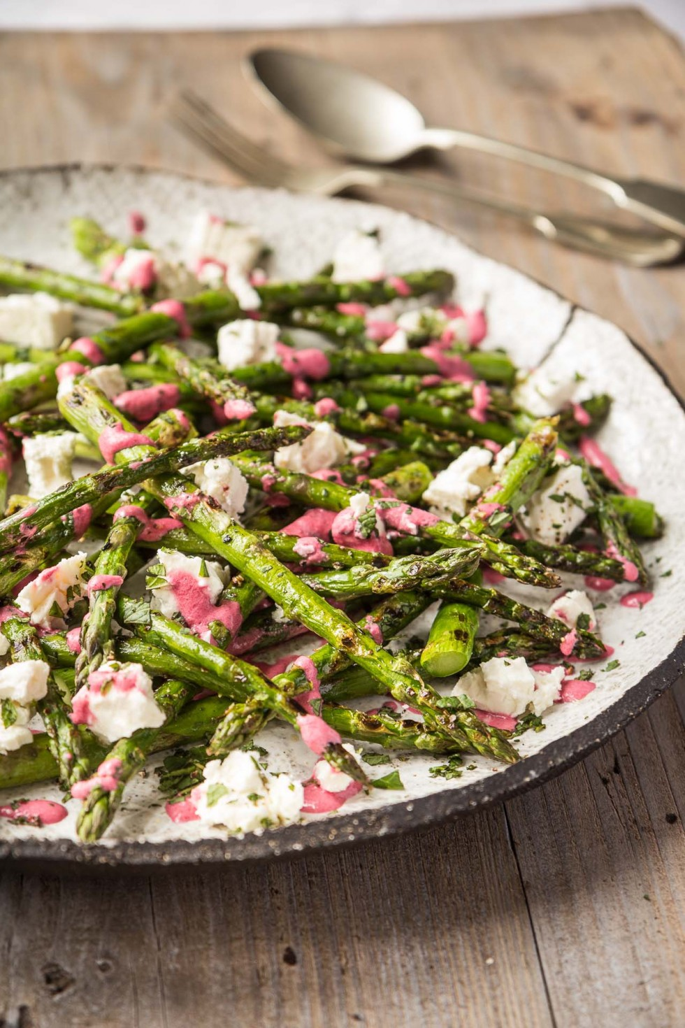 Grilled asparagus with feta and beetroot dressing