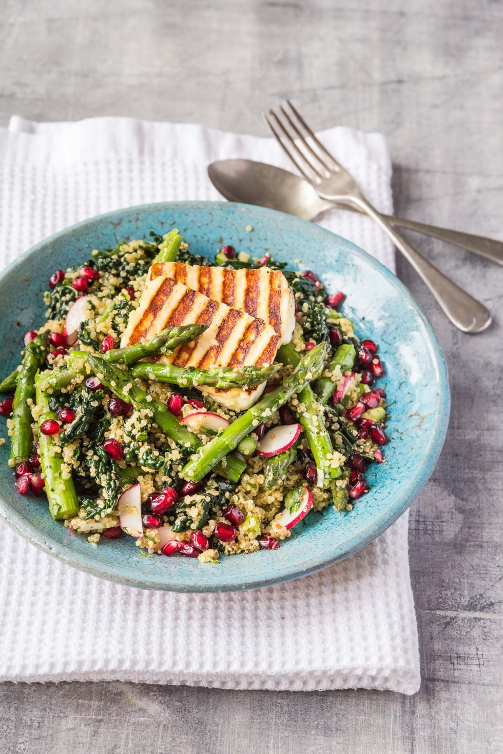 Quinoa 'tabbouleh' with asparagus, halloumi, kale, pomegranate and fresh herbs