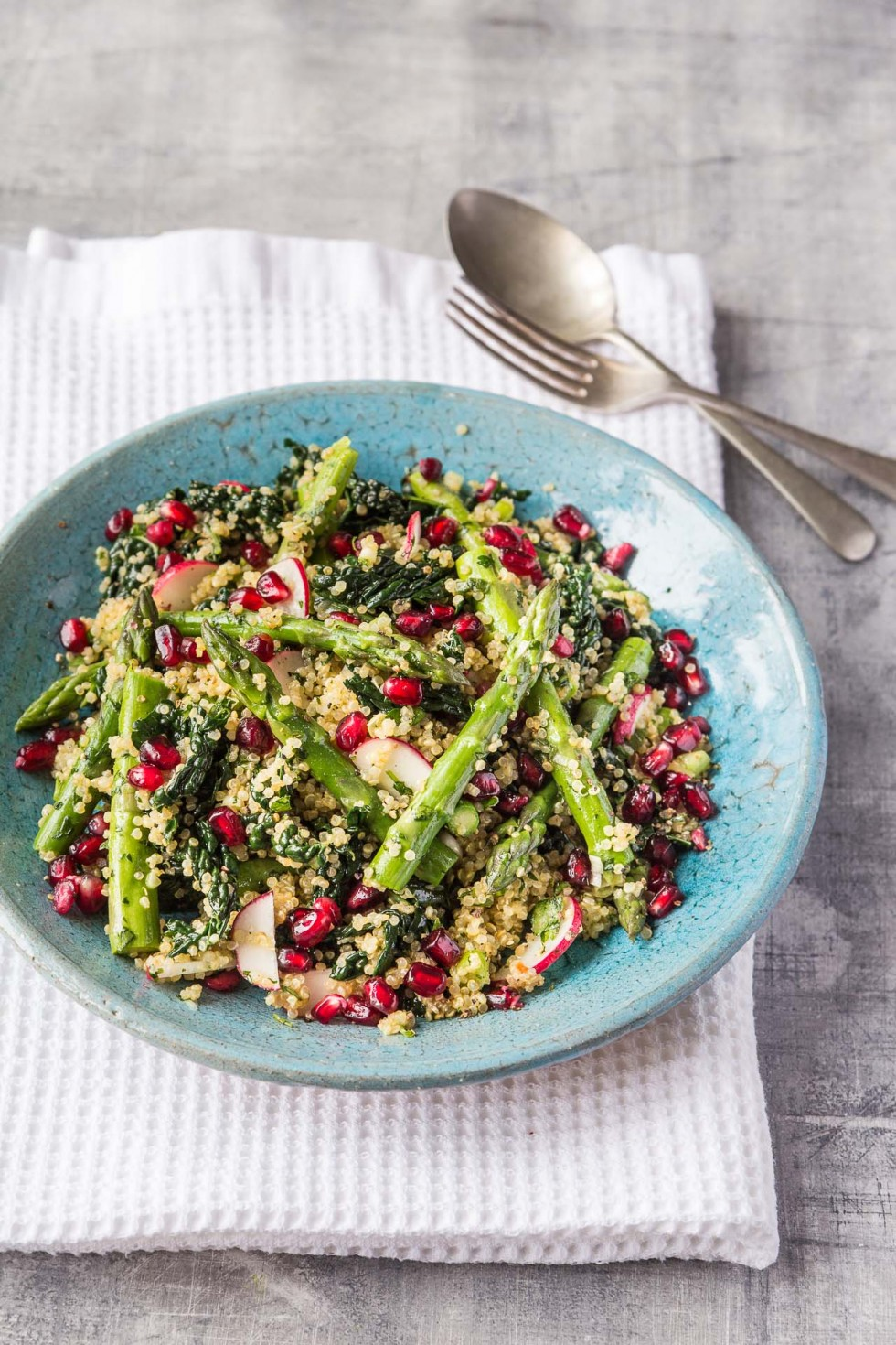 Quinoa 'tabbouleh' with asparagus, kale, pomegranate and fresh herbs